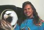 photo of Ernie Apodaca with eagle chair