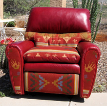 photo of newest recliner style in dark red, leather with fabric accents